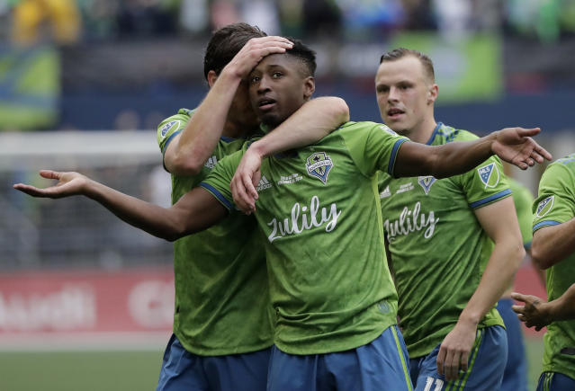 Seattle Sounders' Kelvin Leerdam celebrates after scoring against the Toronto FC, Sunday, Nov. 10, 2019, during the second half of the MLS Cup championship soccer match in Seattle. (AP Photo/Ted S. Warren)