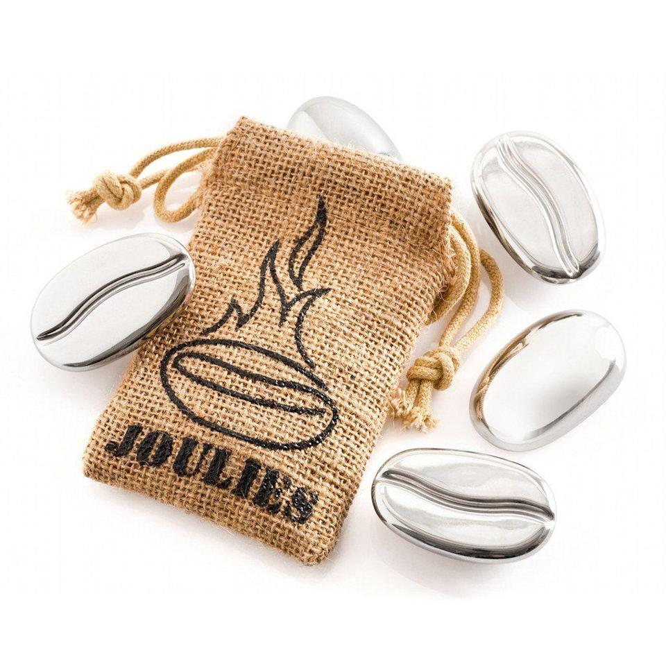"<p><strong>Coffee Joulies</strong><br>Some Shark Tank products create better options than what's currently on the market, and others invent something totally new. That was the case with <a href=""https://www.joulies.com/"" rel=""nofollow noopener"" target=""_blank"" data-ylk=""slk:Coffee Joulies"" class=""link rapid-noclick-resp"">Coffee Joulies</a>, little metal beans that take coffee to the perfectly drinkable temperature in seconds — and keep it there. The product and business model charmed the sharks so much, <a href=""http://www.uticaod.com/x1578915814/Shark-Tank-exposure-boosts-Coffee-Joulies-inventers"" rel=""nofollow noopener"" target=""_blank"" data-ylk=""slk:four of them invested together"" class=""link rapid-noclick-resp"">four of them invested together</a>.</p><span class=""copyright"">Photo: Courtesy of Coffee Joulies.</span>"