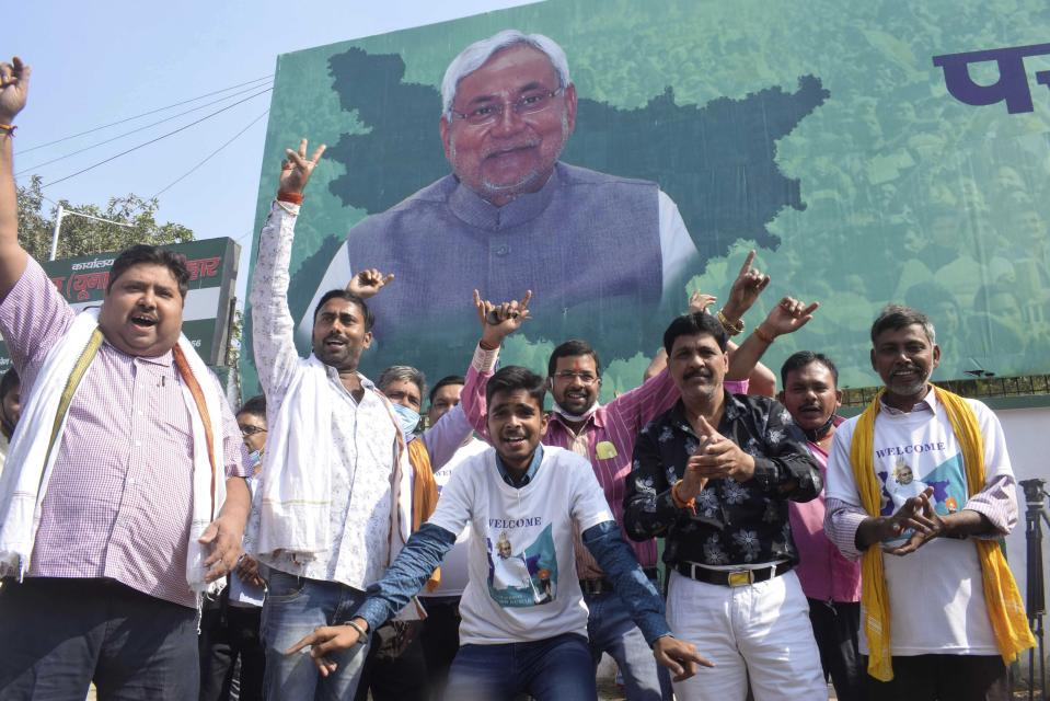 Supporters of Janata Dal (United) celebrate the lead of their party alliance in initial results for the Bihar state assembly polls, in Patna, India, Tuesday, Nov. 10, 2020. (AP Photo/Aftab Alam Siddiqui)