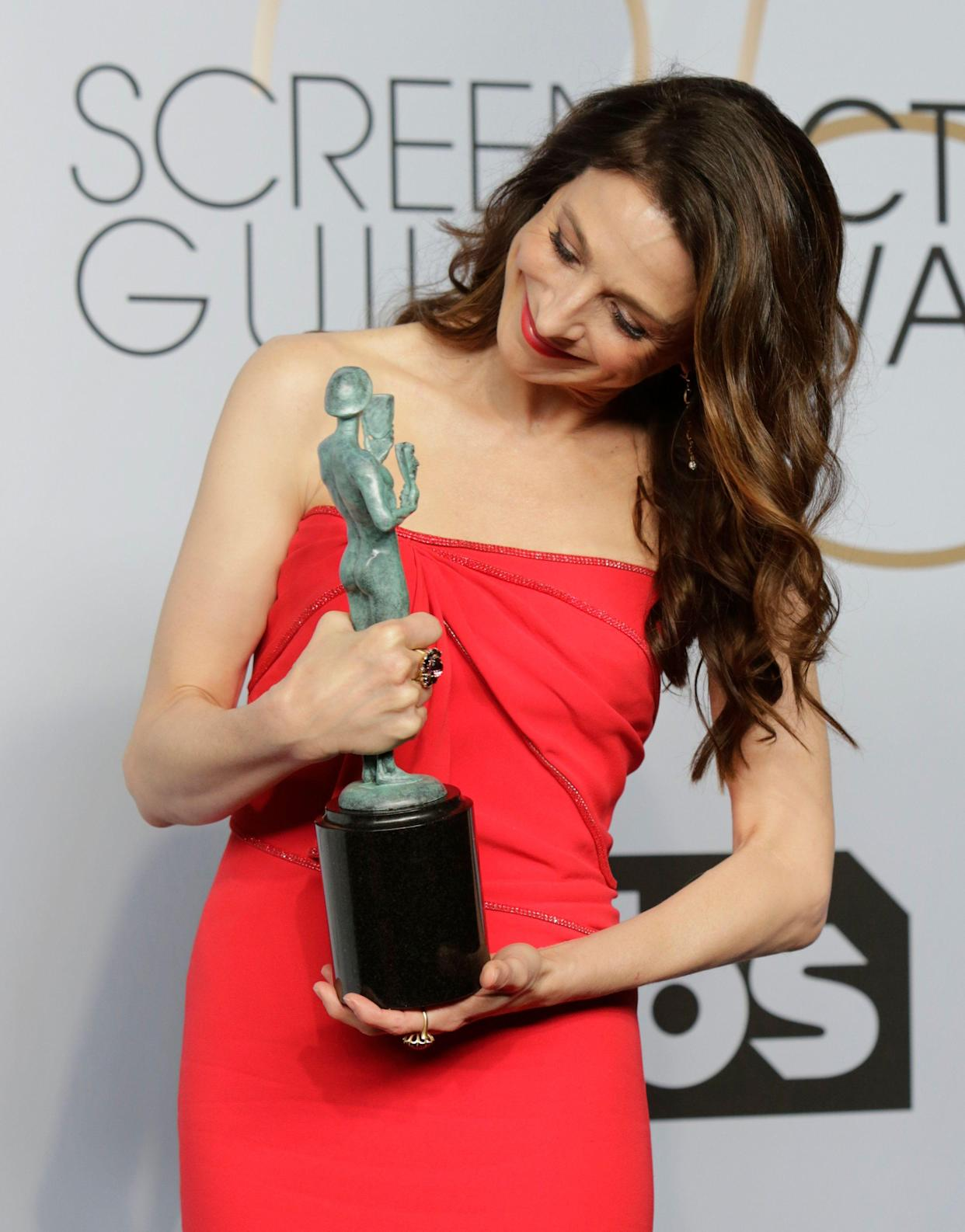 """25th Screen Actors Guild Awards – Photo Room – Los Angeles, California, U.S., January 27, 2019 - Marin Hinkle poses backstage with her Performance by an Ensemble in a Comedy Series award for """"The Marvelous Mrs. Maisel"""". REUTERS/Monica Almeida"""