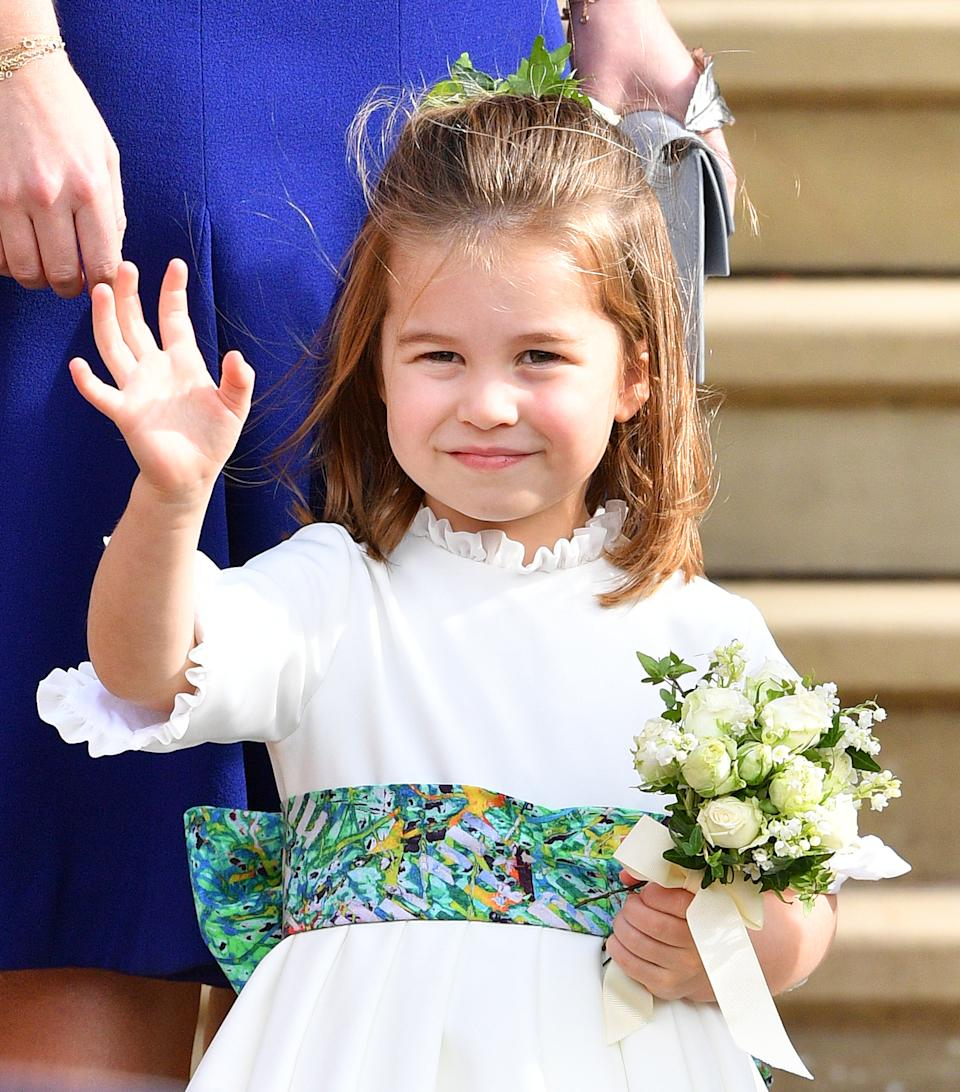 Princess Charlotte of Cambridge attends the wedding of Princess Eugenie of York and Jack Brooksbank at St George's Chapel on October 12, 2018 in Windsor, England.