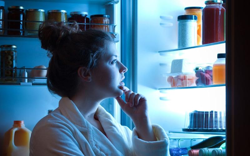 Stock image of a woman looking into a fridge -  YinYang/ E+