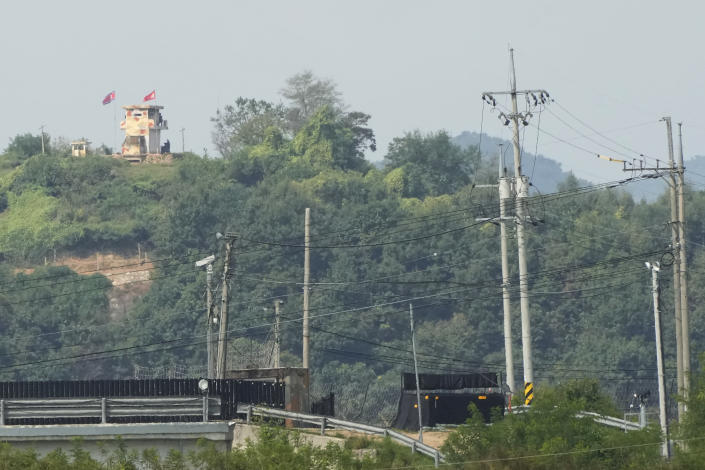 A military guard post of North Korea, left top, is seen in Paju, near the border with North Korea, South Korea, Friday, Sept. 24, 2021. North Korean leader Kim Jong Un's powerful sister, Kim Yo Jong, said Friday, North Korea is willing to resume talks with South Korea if it doesn't provoke the North with hostile policies and double standards.(AP Photo/Ahn Young-joon)