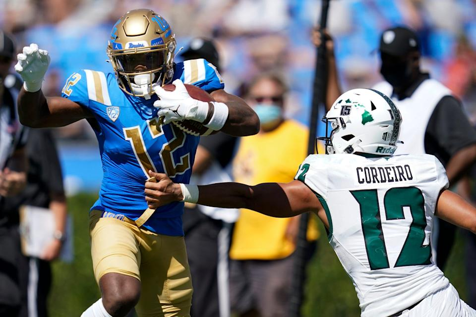 UCLA defensive back Martell Irby (12) runs to the end zone for a touchdown past Hawaii quarterback Chevan Cordeiro (12) during the second half.