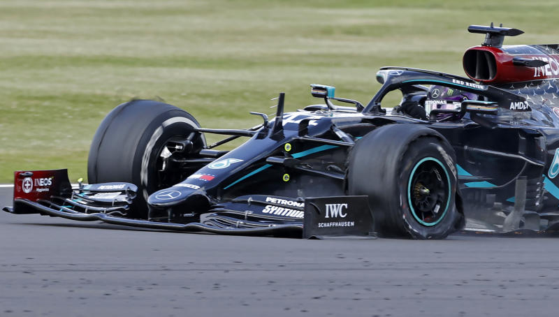 The punctured tyre of Mercedes' British driver Lewis Hamilton punctures is pictured as he goes on to win the Formula One British Grand Prix at the Silverstone motor racing circuit in Silverstone, central England on August 2, 2020. - Lewis Hamilton survived a dramatic finale to win the British Grand Prix on Sunday, just making it across the line on three tyres to beat a fast closing Max Verstappen on Red Bull. The defending world champion claimed his seventh British Grand Prix win as Ferarri's Charles Leclerc came third and Daniel Ricciardo of Renault fourth. (Photo by ANDREW BOYERS / POOL / AFP) (Photo by ANDREW BOYERS/POOL/AFP via Getty Images)