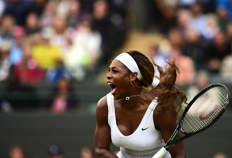 US player Serena Williams serves to France's Alize Cornet during their women's singles match at Wimbledon on June 28, 2014