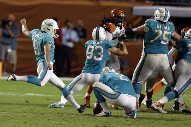 Miami Dolphins kicker Caleb Sturgis (9) boots the ball for a field goal to tie an NFL football game during the second half against the Cincinnati Bengals, Thursday, Oct. 31, 2013, in Miami Gardens, Fla. (AP Photo/Lynne Sladky)