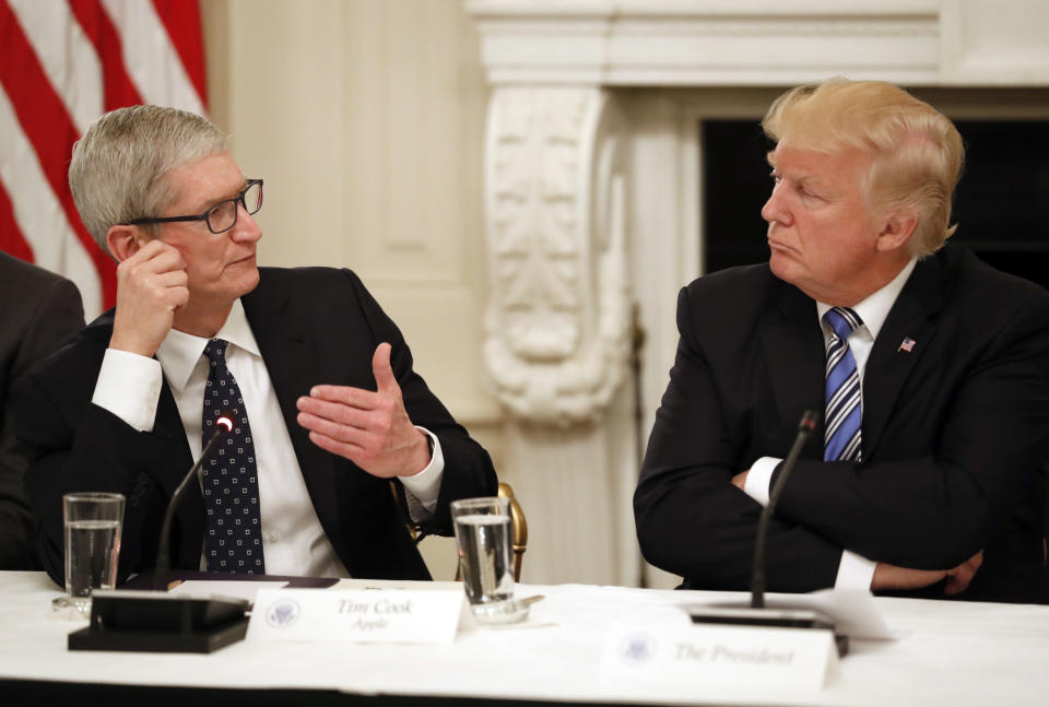Tim Cook, CEO of Apple, speaks as President Donald Trump listens during an American Technology Council roundtable in the State Dinning Room of the White House, Monday, June 19, 2017. (AP Photo/Alex Brandon)