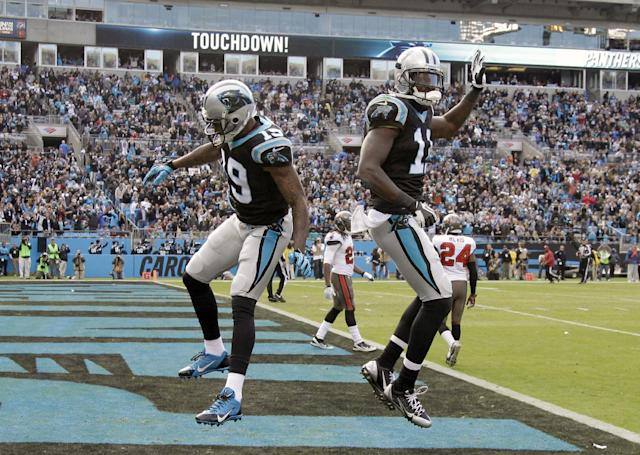 Carolina Panthers' Ted Ginn (19) and Brandon LaFell (11) celebrate Ginn's touchdown catch against the Tampa Bay Buccaneers in the second half of an NFL football game in Charlotte, N.C., Sunday, Dec. 1, 2013. (AP Photo/Bob Leverone)