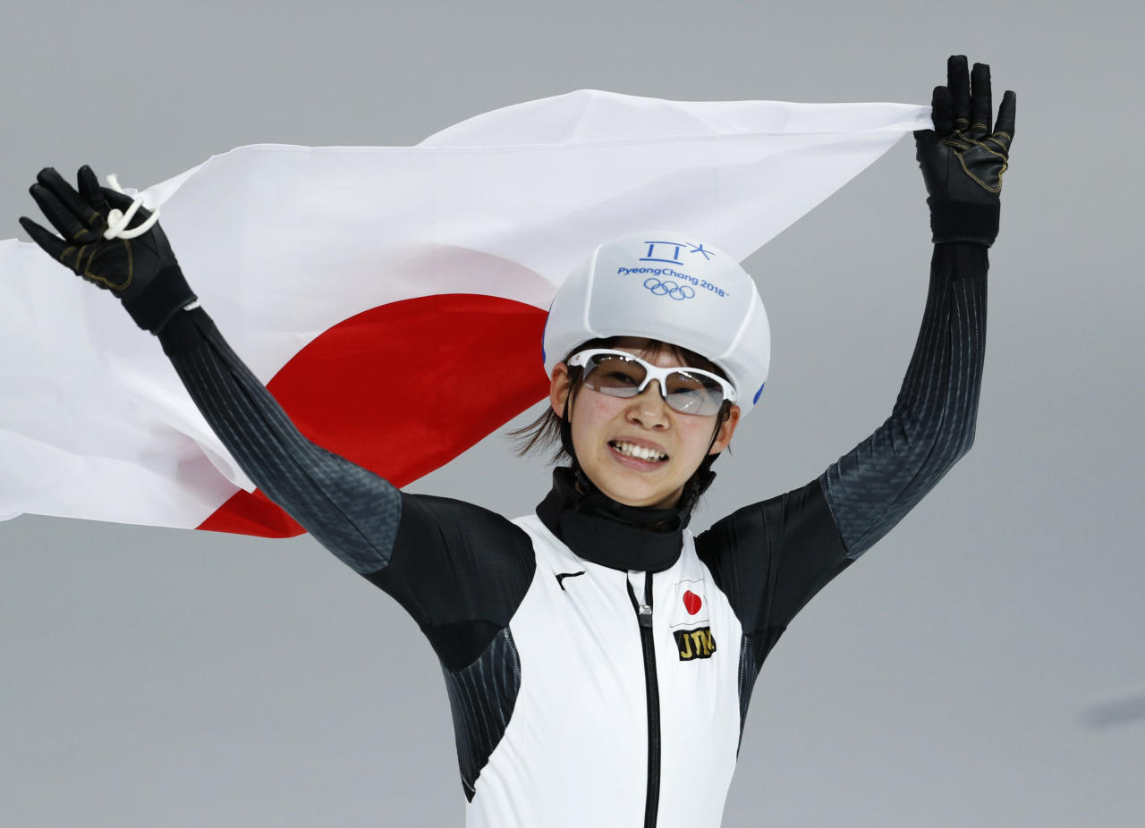 <p>Gold medalist Nana Takagi of Japan celebrates with the national flag after the women's mass start final speedskating race at the Gangneung Oval at the 2018 Winter Olympics in Gangneung, South Korea, Saturday, Feb. 24, 2018. (AP Photo/John Locher) </p>