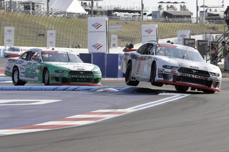 Chase Briscoe (98) leads Austin Cindric (22) into Turn 12 during the NASCAR Xfinity Series auto race at Charlotte Motor Speedway in Concord, N.C., Saturday, Sept. 28, 2019. (AP Photo/Gerry Broome)