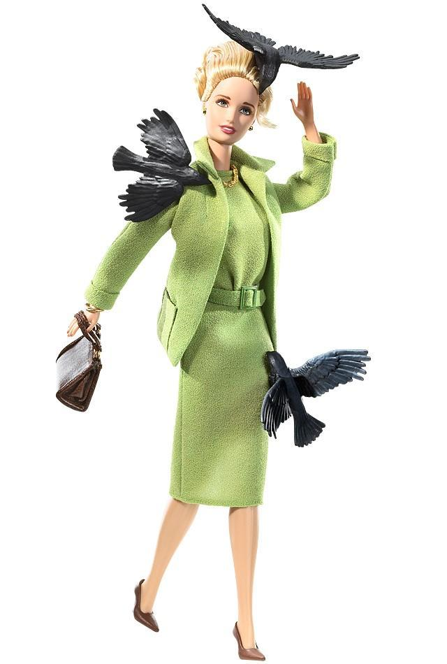 "<div class=""caption-credit""> Photo by: barbiecollector.com</div><b>Alfred Hitchcock's ""The Birds"" doll, released in 2008 for $40</b> <br> Poor Tippi Hedren will be tormented by those black birds for all eternity. At least her green suit looks fab."