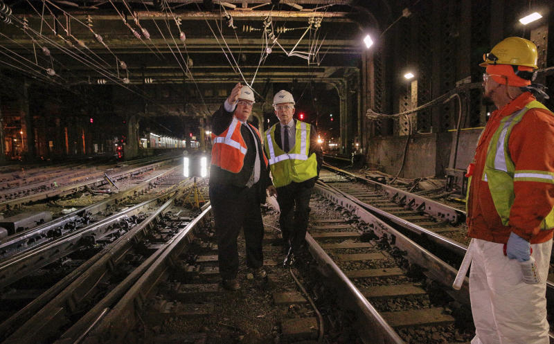 In this April 6, 2017 photo provided by Amtrak, Amtrak President and CEO Wick Moorman, right, and Amtrak Deputy General Manager Steve Young assess the tracks at New York's Penn Station. Amtrak officials said on Thursday, April 27, 2017 that necessary work on tracks and signals at New York's Pennsylvania Station will begin in May and continue through the summer. Rail travelers who have endured major disruptions recently at the nation's busiest rail station are likely to see more delays this summer because New York's Penn Station is in dire need of repair work. (Amtrak via AP)