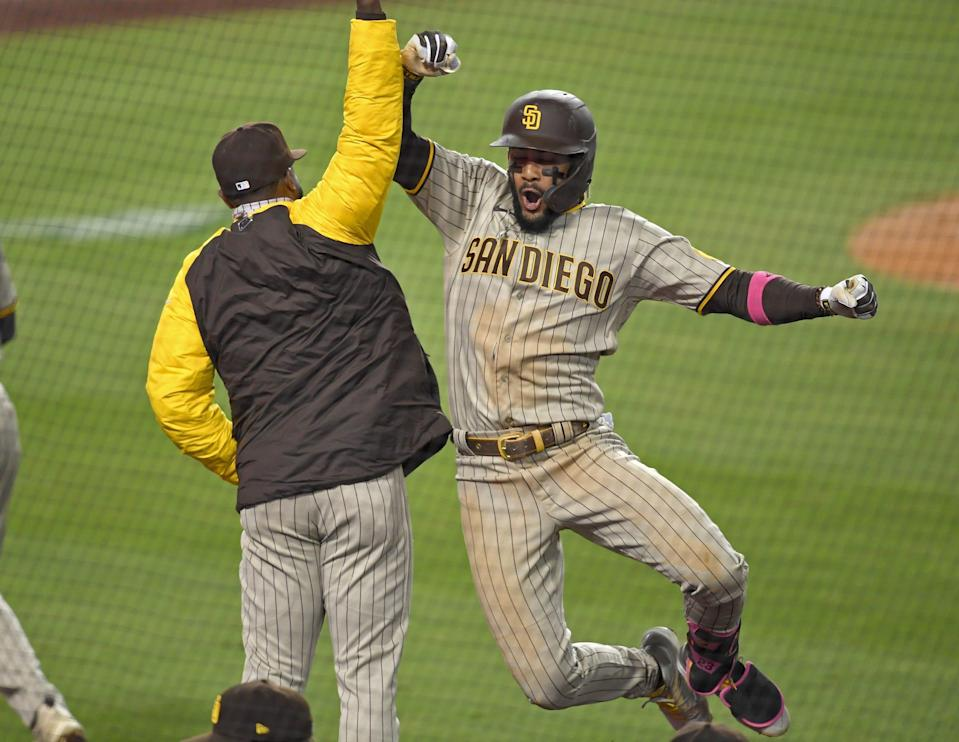 San Diego Padres shortstop Fernando Tatis Jr. celebrates after hitting a home run in the fifth inning against the Los Angeles Dodgers.