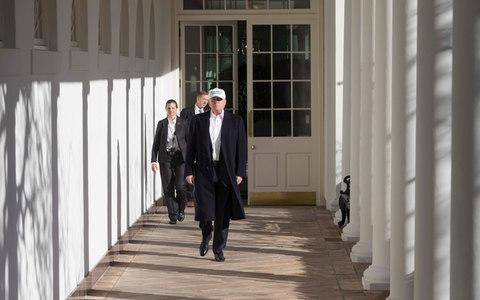 Trump walks along the West Wing Colonnade - Credit: Official White House Photo