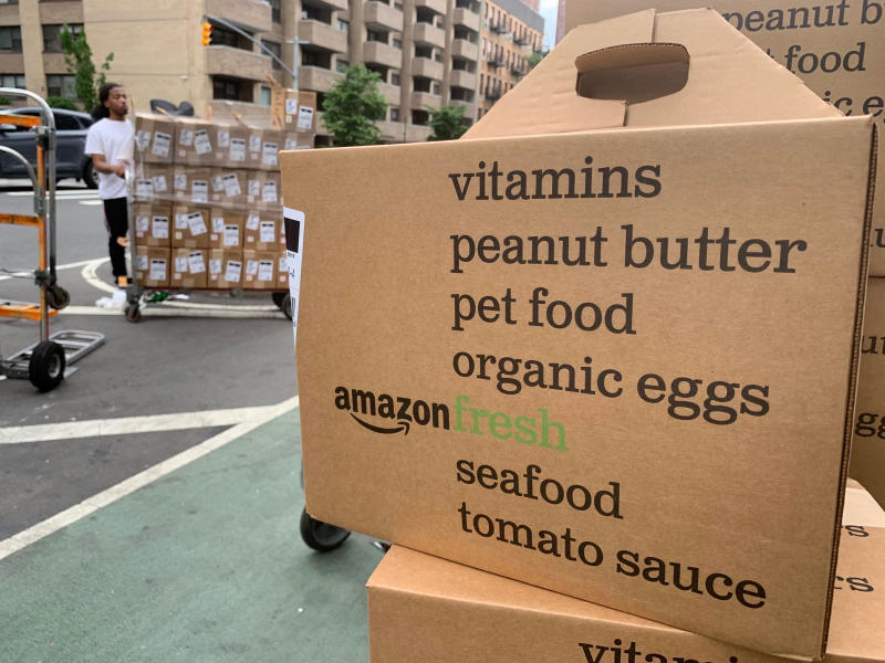 In this Sunday, June 16, 2019, boxes of Amazon Fresh deliveries are unloaded in New York. If you aren't already tracking your spending, do so. Pay close attention to all the payments you make _ recurring or not _ and to the forms of payment: credit cards, Venmo, etc.  Subscription services are attractive because they're easy to sign up for and come with minimal monthly financial commitment, said researcher Dhaval Moogimane. But small costs can add up, and prices can increase over time.(AP Photo/Jenny Kane)