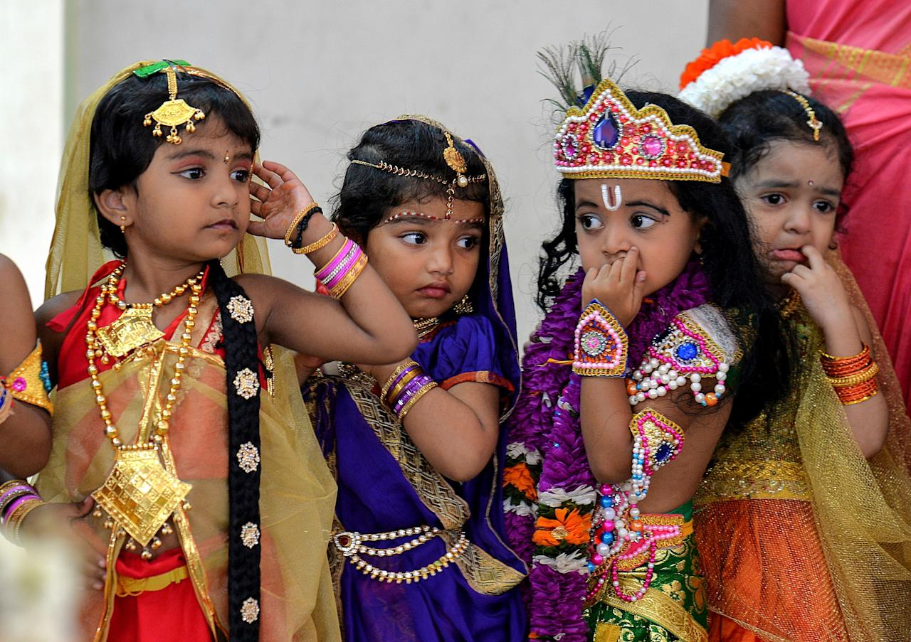 <p>Indian children dressed as the Hindu deity Krishna and his cosort Radha wait in line to participate in a fancy dress competition held as part of Krishna Janmashtami celebrations at a kindergarten in Bangalore on September 1, 2018. – Krishna Janmashtami is an annual Hindu festival that celebrates the birth of the Hindu deity Krishna, the eighth avatar of Vishnu. (Photo by MANJUNATH KIRAN/AFP/Getty Images) </p>