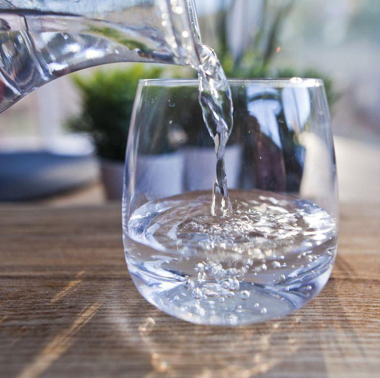 """<p>Boehmer says water is always your best bet when it comes to hydration. The specific amount you need each day varies depending on <a href=""""https://www.menshealth.com/health/a27822478/how-much-water-should-i-drink-a-day/"""" rel=""""nofollow noopener"""" target=""""_blank"""" data-ylk=""""slk:temperature, elevation, and activity level."""" class=""""link rapid-noclick-resp"""">temperature, elevation, and activity level.</a> </p><p> The National Academies of Sciences, Engineering and Medicine says that guys """"who appear to be adequately hydrated"""" consume about 125 ounces of liquid a day. </p>"""