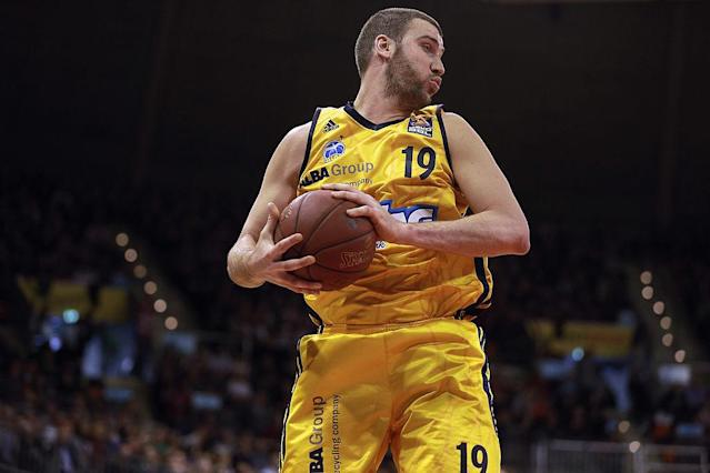 Albert Miralles pulls down a rebound for Alba Berlin during a February 2013 game in Munich, Germany. (Bongarts/Getty Images)