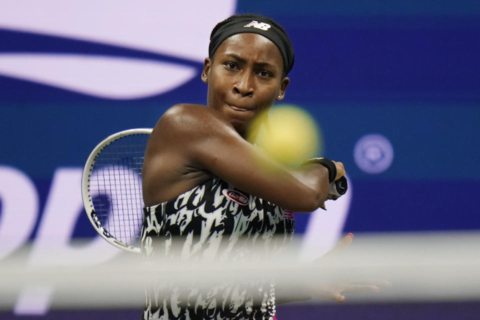 Coco Gauff, of the United States, returns a shot to Sloane Stephens, of the United States, during the second round of the US Open tennis championships, Wednesday, Sept. 1, 2021, in New York. (AP Photo/Frank Franklin II)