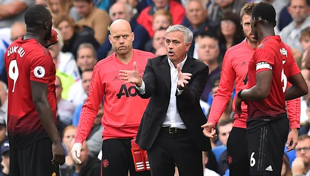 Manchester United's Portuguese manager Jose Mourinho gestures as he talks with his players.