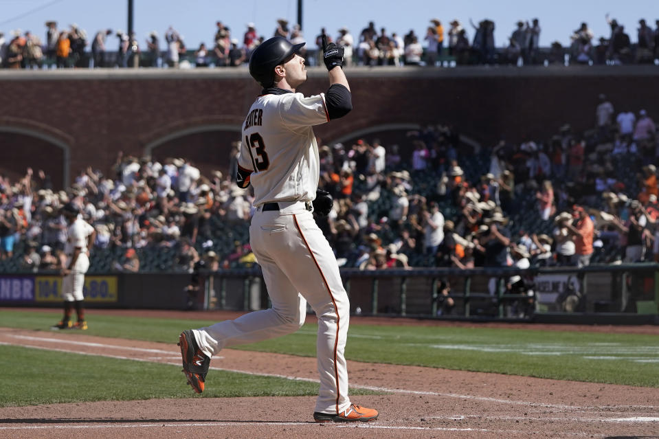 San Francisco Giants' Austin Slater gestures after hitting a two-run home run against the San Diego Padres during the eighth inning of a baseball game in San Francisco, Saturday, May 8, 2021. (AP Photo/Jeff Chiu)