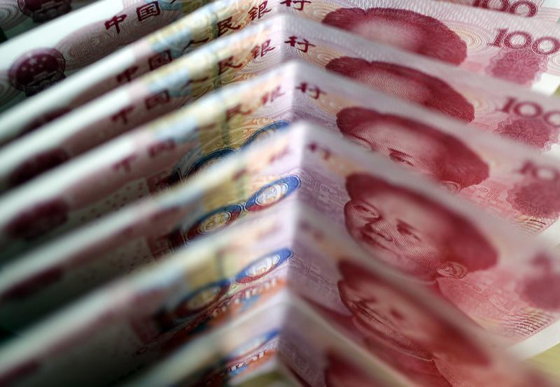 One-hundred Yuan notes are seen in this picture illustration in Beijing