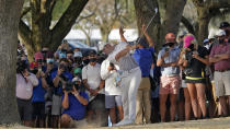 Rory McIlroy, of Northern Ireland, hits from the rough along the 16th fairway during the second round of the Arnold Palmer Invitational golf tournament Friday, March 5, 2021, in Orlando, Fla. (AP Photo/John Raoux)
