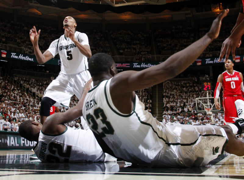 Michigan State's Draymond Green (23) and Branden Dawson (22) lie on the court as Adrien Payne (5) watches the ball during the first half of an NCAA college basketball game against Ohio State, Sunday, March 4, 2012, in East Lansing, Mich. Ohio State won 72-70. Dawson suffered an injured left knee on the play. (AP Photo/Al Goldis)
