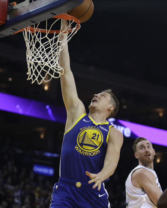 Golden State Warriors' Jonas Jerebko (21) lays up a shot against the Boston Celtics during the first half of an NBA basketball game Tuesday, March 5, 2019, in Oakland, Calif. (AP Photo/Ben Margot)