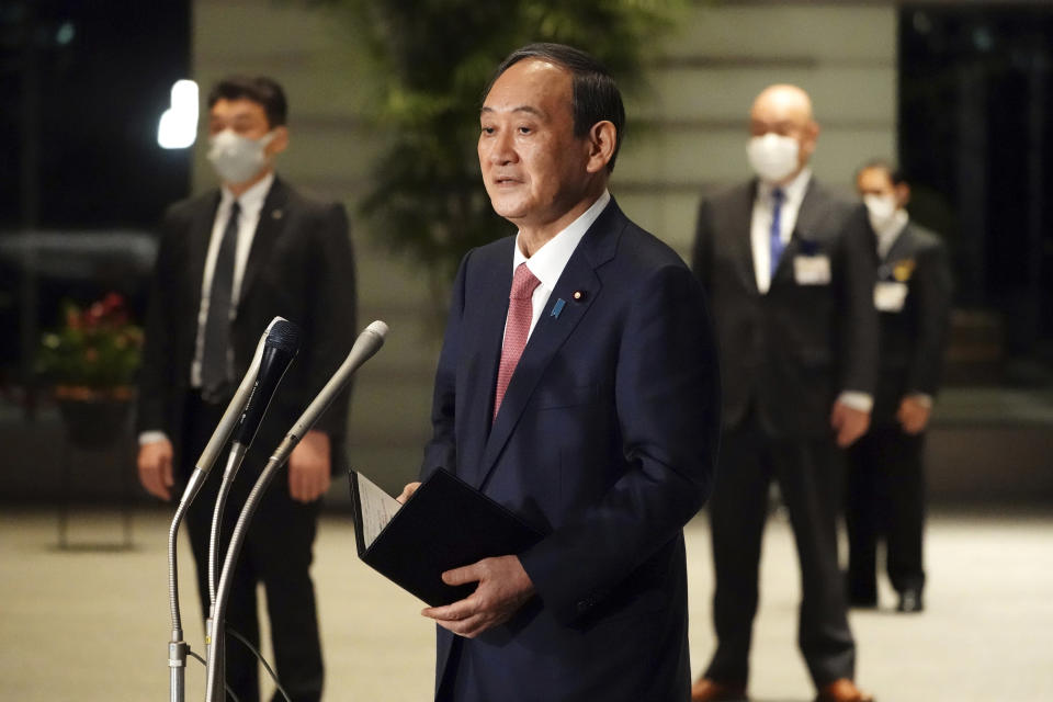 Japanese Prime Minister Yoshihide Suga speaks to media after a government task force meeting for the new virus measures, at the prime minister's office Friday, April 9, 2021, in Tokyo. Japan announced Friday that it will raise the coronavirus alert level in Tokyo to allow tougher measures to curb the rapid spread of a more contagious variant ahead of the Summer Olympics. (AP Photo/Eugene Hoshiko, Pool)