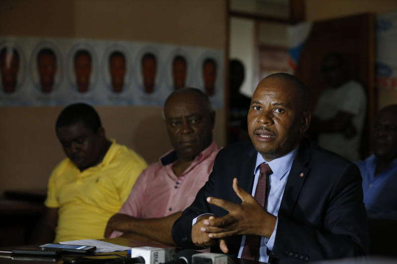 Senator Nenel Cassy speaks as Senator Sorel Jacinthe, center, and lawyer Andre Michel listen during a press conference to announce plans for a massive protest march to the United Nations headquarters the following day, in Port-au-Prince, Haiti, Thursday, Oct. 3, 2019. As the public appearances of President Jovenel Moise fade with Haiti's deepening political turmoil, dozens of people from political parties old and new are vying to become the country's next leader as they seize on widespread discontent.(AP Photo/Rebecca Blackwell)