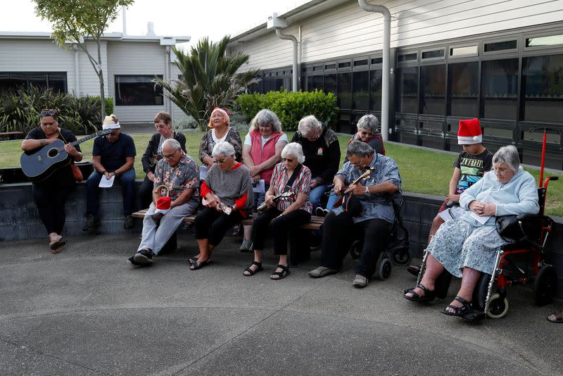 People observe a minute of silence as the pay their respects to the victims of the White Island volcano eruption, at the hospital in Whakatane