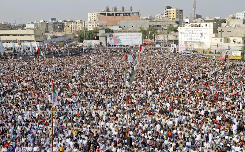 Supporters of Pakistani political party Muttahida Qaumi Movement (MQM), attend a rally to condemn the attack on 14-year-old schoolgirl Malala Yousufzai, who was shot last Tuesday by the Taliban for speaking out in support of education for women, in Karachi, Pakistan, Sunday, Oct. 14, 2012. Tens of thousands rallied in Pakistan's largest city Sunday in support of a 14-year-old girl who was shot and critically wounded by the Taliban for promoting girls' education and criticizing the militant group. (AP Photo/Shakil Adil)