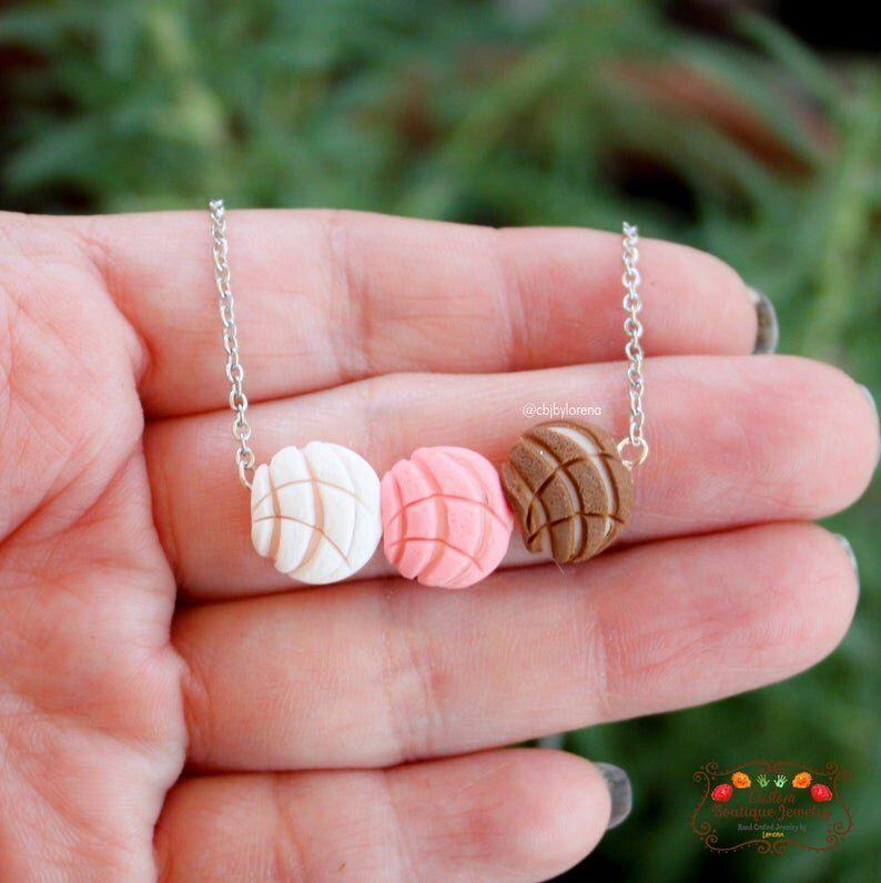 """<a href=""""https://fave.co/3c2UPtU"""" target=""""_blank"""" rel=""""noopener noreferrer"""">CBJ by Lorena</a> is a California-basedLatinx-owned Etsy shop that specializes in colorful clay jewelry like conchas and florals. Shop this <a href=""""https://fave.co/2ZGre4f"""" target=""""_blank"""" rel=""""noopener noreferrer"""">Concha Charm Necklace in color for $17</a> at <a href=""""https://fave.co/3c2UPtU"""" target=""""_blank"""" rel=""""noopener noreferrer"""">CBJ by Lorena on Etsy.</a>"""
