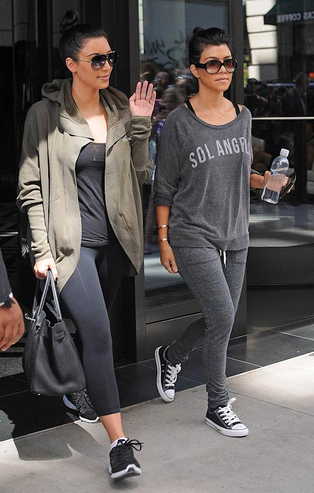 """Sisters Kim and Kourtney Kardashian squeezed in a trip to the gym in the Big Apple on Wednesday. Kim is returning to the city that will be her and her new husband's home for the first time since becoming Mrs. Kris Humphries last month. <a href=""""http://www.splashnewsonline.com"""" target=""""new"""">Splash News</a> - August 31, 2011"""