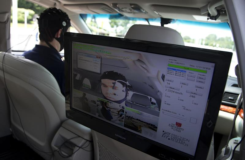 Russ Martin of American Automobile Association (AAA), is seen on a monitor in a research vehicle skull cap to the research vehicle during a demonstrations in support of their new study on distracted driving in Landover, Md., Tuesday, June 11, 2013. (AP Photo/Manuel Balce Ceneta)