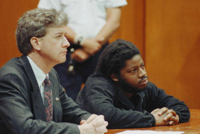 FILE- In this May 16, 1989 file photo, defendant Philip Copeland, right, and his attorney Frank Hancock listen in criminal court in New York on as Justice Thomas Demakos sentences him to a maximum term of 25 years to life in prison for the murder of New York City rookie police officer Edward Byrne. Copeland, along with three other men who were found guilty of Byrnes murder, will go before a New York state parole board in November 2012. (AP Photo/Richard Drew, File)