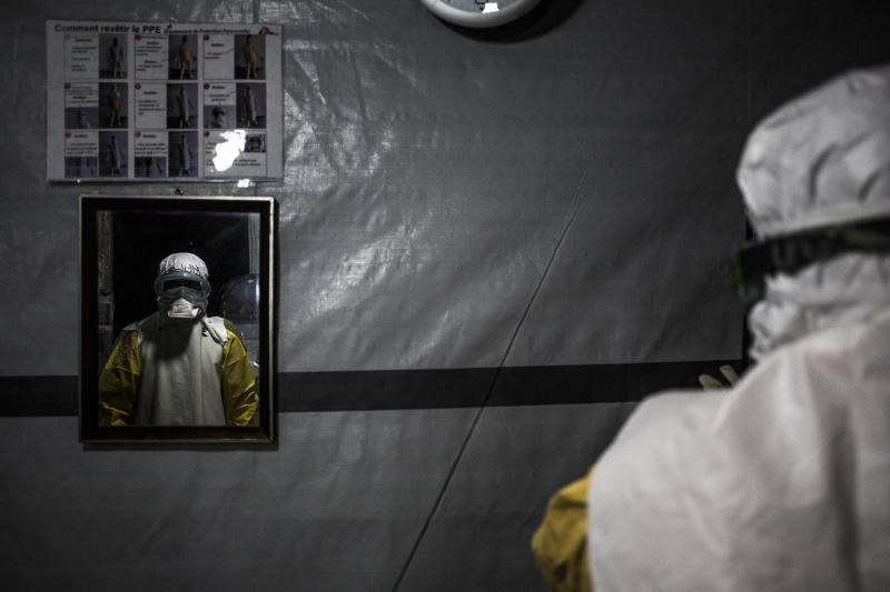 In this photo taken Saturday, Nov. 3, 2018 and made available Tuesday, Dec. 4, 2018, a health worker is seen wearing his personal protective equipment before entering the red zone of a Medecins Sans Frontieres (MSF) supported Ebola treatment centre in Butembo, Congo. Congo's deadly Ebola outbreak is now the second largest in history, behind the devastating West Africa outbreak that killed thousands a few years ago, according to the World Health Organization. (John Wessels/Medecins Sans Frontieres via AP)