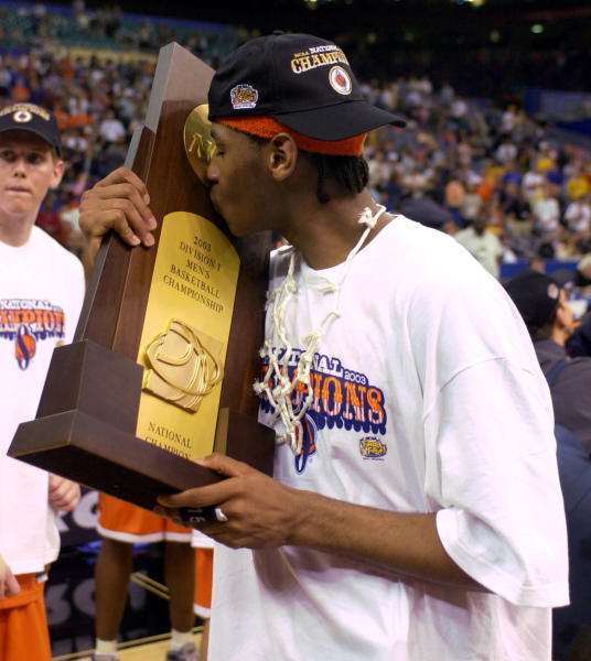 FILE - In this April 7, 2003, file photo, Syracuse's Carmelo Anthony kisses the trophy after winning the championship game 81-78 against Kansas at the NCAA college basketball Final Four in New Orleans. With no Final Four on tap this weekend thanks to the coronavirus, we instead put together a list of the greatest one-and-done players ever. Anthony Davis and Syracuses Carmelo Anthony top our list after leading their teams to national tiles their lone season in college. (AP Photo/Ed Reinke, File)