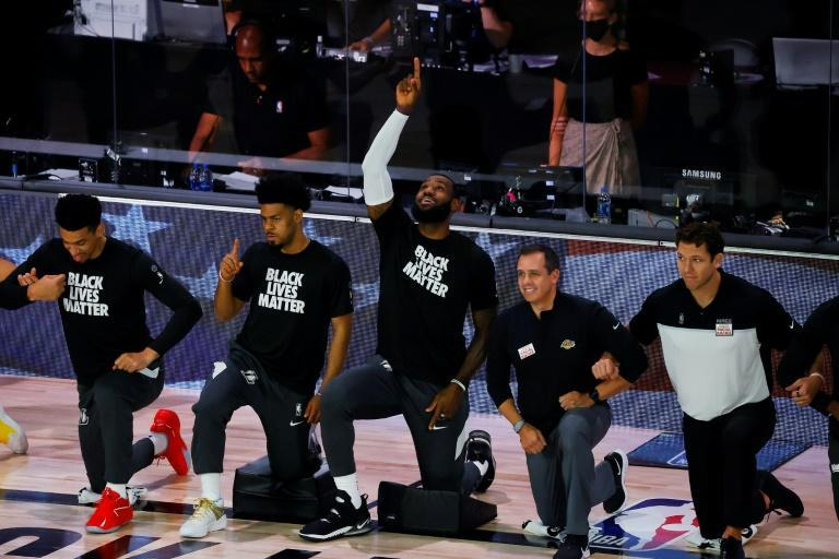 Los Angeles star LeBron James points to the sky following the national anthem before the start of the Lakers' final regular-season NBA game against the Sacramento Kings