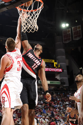 HOUSTON, TX - FEBRUARY 8: LaMarcus Aldridge #12 of the Portland Trail Blazers shoots against Cole Aldrich #31 of the Houston Rockets on February 8, 2013 at the Toyota Center in Houston, Texas. (Photo by Bill Baptist/NBAE via Getty Images)