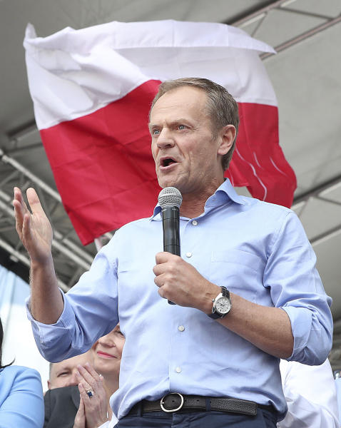 European Union Council President Donald Tusk leads a march celebrating Poland's 15 years in the EU and stressing the nation's attachment to the 28-member bloc ahead of May 26 key elections to the European Parliament, in Warsaw, Poland, Saturday, May 18, 2019. (AP Photo/Czarek Sokolowski)