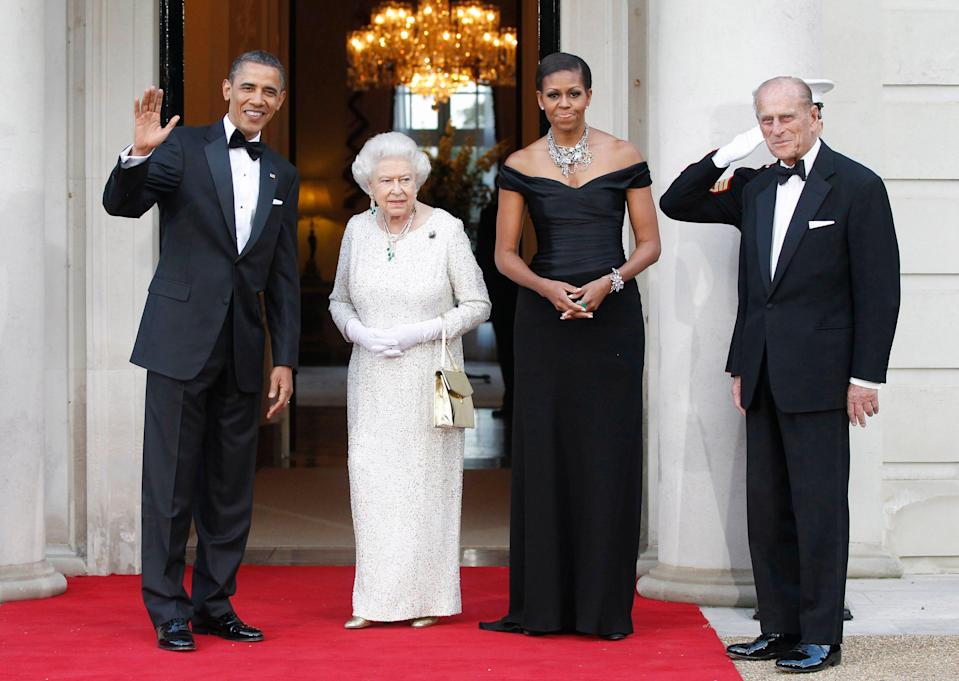 President Barack Obama and first lady Michelle Obama welcome Queen Elizabeth II and Prince Philip for a reciprocal dinner at Winfield House, the American ambassador's residence in London, May 25, 2011.