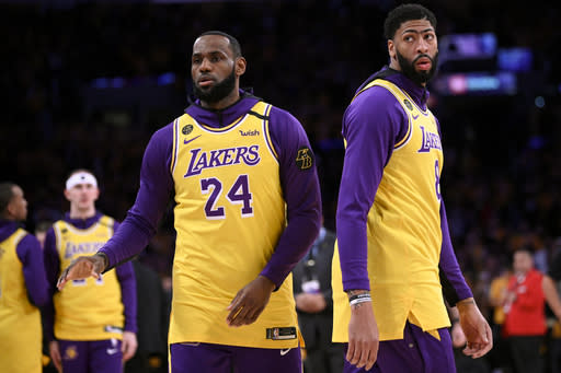 Los Angeles Lakers' LeBron James, left, and Anthony Davis warm up while wearing jerseys with the No.s 24 and 8, respectively, in honor of Kobe Bryant, prior to the team's NBA basketball game against the Portland Trail Blazers in Los Angeles, Friday, Jan. 31, 2020. (AP Photo/Kelvin Kuo)