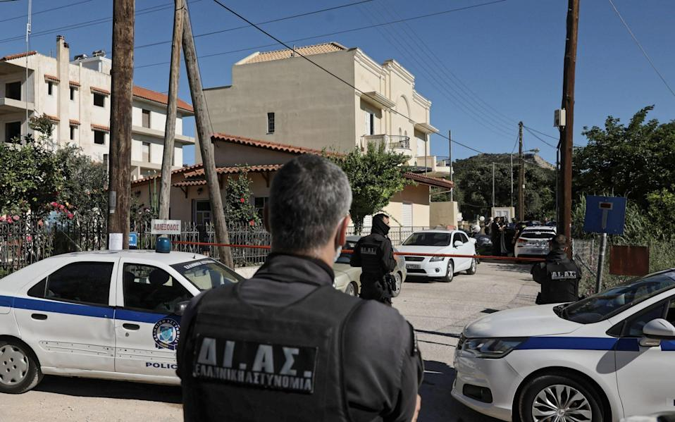 Greek police outside the property in Athens where Ms Crouch was murdered - John Liakos/Intime News/Athena Pictures