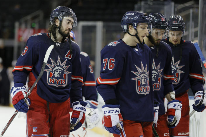 Mika Zibanejad #93, Jonny Brodzinski #76, Phillip Di Giuseppe #33, and Brett Howden #21 of the New York Rangers react after their loss during the third period against the Boston Bruins at Madison Square Garden Sunday, Feb. 28, 2021, in New York. (Sarah Stier/Pool Photo via AP)
