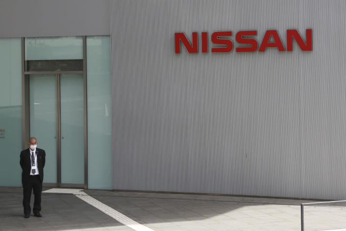 A man stands at Nissan Motor Co.'s global headquarters in Yokohama, near Tokyo, Tuesday, June 22, 2021. Nissan Chief Executive Makoto Uchida pleaded for patience from disgruntled shareholders Tuesday, promising a turnaround at the Japanese automaker, which is projecting a third year of losses as it struggles to distance itself from a scandal over its former Chairman Carlos Ghosn. (AP Photo/Koji Sasahara)