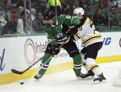 Dallas Stars center Jason Spezza (90) battles Boston Bruins defenseman Jeremy Lauzon (79) for the puck in the first period of an NHL hockey game Friday, Nov. 16, 2018, in Dallas. (AP Photo/Richard W. Rodriguez)