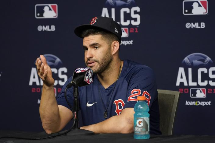 Boston Red Sox's J.D. Martinez responds to questions during a news conference before baseball practice in Houston, Thursday, Oct. 14, 2021. The Red Sox play the Houston Astros in Game 1 of the American League Championship Series on Friday. (AP Photo/Tony Gutierrez)